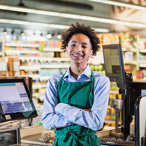 young smiling grocery store clerk